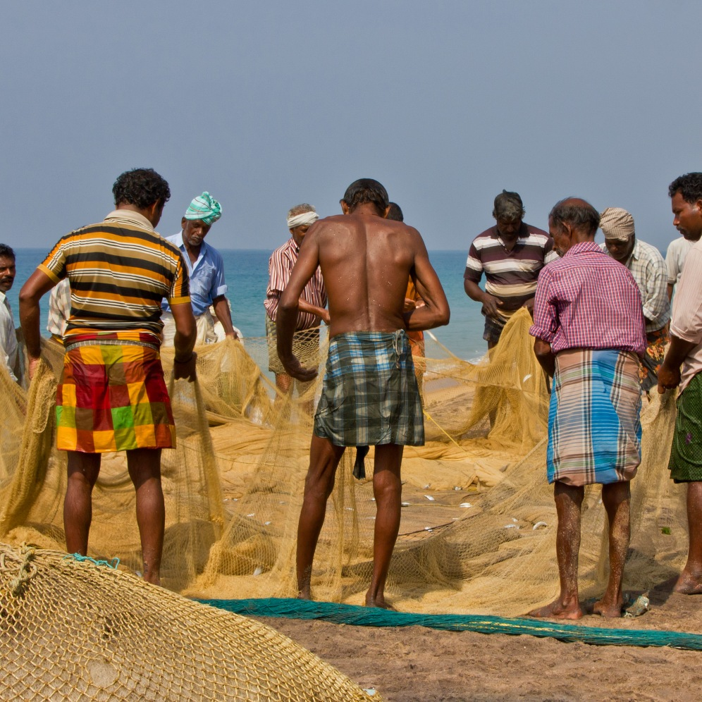 Fishermen hauling in their meagre catch